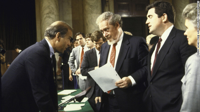 Senate Judiciary Committee Chairman Joseph R. Biden Jr., chatting with Supreme Court Nominee Robert H. Bork and others; after first day of hearings to confirm Bork.  (Photo by Terry Ashe//Time Life Pictures/Getty Images)