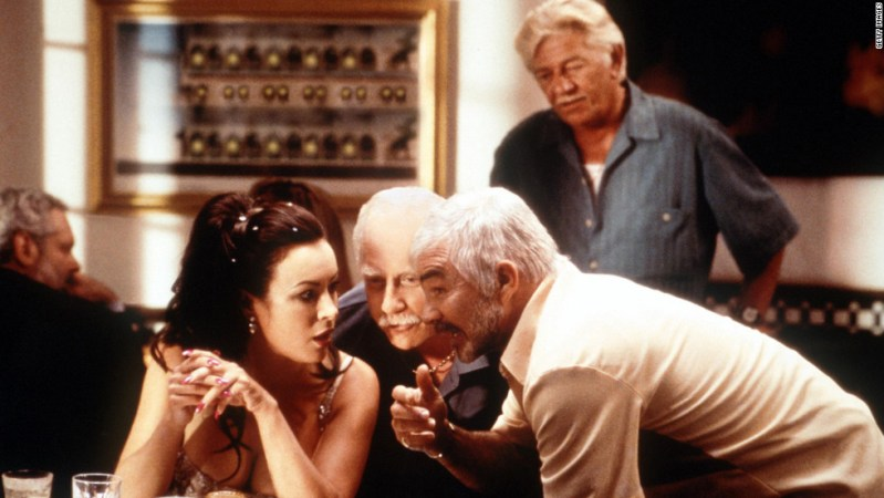 "Reynolds gets close to Jennifer Tilly and Richard Dreyfuss in 2000's ""The Crew."""