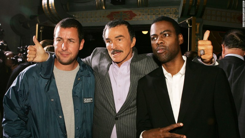 "Reynolds poses with Adam Sandler, left, and Chris Rock after a remake of ""The Longest Yard"" in 2005."