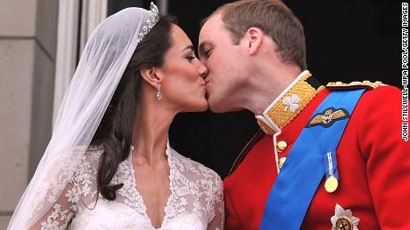 William and Catherine kiss on the balcony of Buckingham Palace after their wedding ceremony in London in 2011.