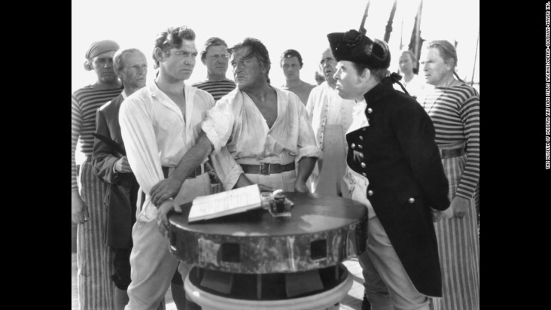"Clark Gable was in the best picture winner the next year as well, playing Fletcher Christian in the 1935 version of ""Mutiny on the Bounty."" Charles Laughton plays Captain Bligh."