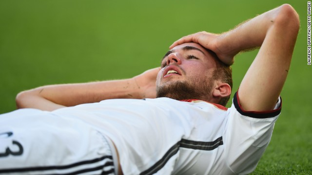 Christoph Kramer of Germany lies on the pitch after a collision during the 2014 World Cup final against Argentina.