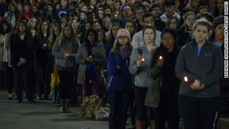 People listen during a vigil at UNC Chapel Hill in February 2015.