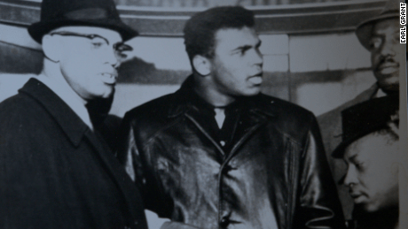 Malcolm X is shown with boxer Muhammad Ali in this image from photographer Earl Grant.