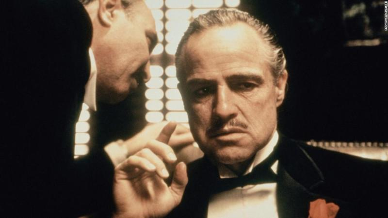 "With his career in decline for nearly a decade, Marlon Brando scored a comeback as Don Vito Corleone, the aging patriarch of a crime family, in Francis Ford Coppola's ""The Godfather."" Brando won his second Oscar for best actor (which he refused), and the movie made a superstar of Al Pacino as the son who takes over the ""family business."" The movie ranked <a href=""http://www.afi.com/100years/movies10.aspx"" target=""_blank"">No. 2 on the American Film Institute's list of the top 100 U.S. films.</a>"