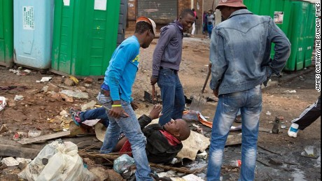 Xenophobic killing in South African township caught by photographer