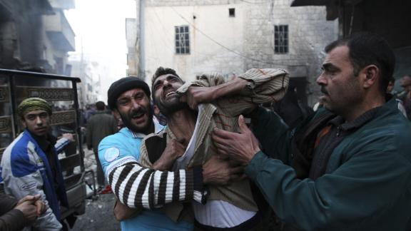 A father reacts after the deaths of two of his children in Aleppo on January 3, 2013.
