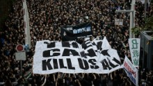 Protesters display a large banner during a rally to support press freedom in Hong Kong on March 2, 2014.