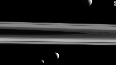 NASA has released a stunning image showing three of Saturn's moons and the planet's iconic rings. Tethys, Enceladus and Mimas were captured in the same shot by the Cassini spacecraft, which has studied the planet and its natural satellites since 2004.