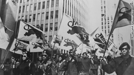 In this July 22, 1968, file photo, Black Panthers march to a news conference in New York to protest at the trial of one of their members, Huey P Newton. Newton was later convicted of manslaughter in the death of an Oakland police officer.