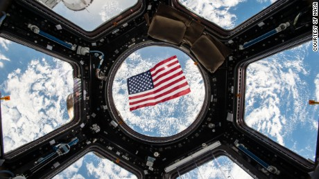 Image Kjell Lindgren released on social media of the US flag floating in the Cupola module.