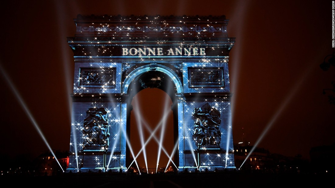 New year celebrations around the world ring in 2017   CNN The Arc de Triomphe in Paris  France  is illuminated by a laser and 3D   Photos  New Year s