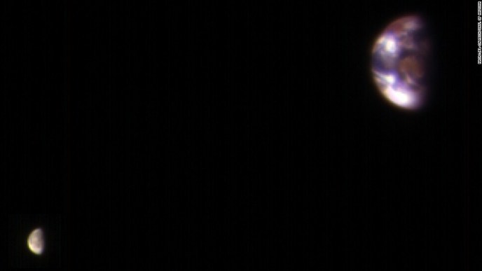 This is what Earth and its moon look like from Mars. The image is a composite of the best Earth image and the best moon image taken on November 20, 2016, by NASA's Mars Reconnaissance Orbiter. The orbiter's camera takes images in three wavelength bands: infrared, red and blue-green. Mars was about 127 million miles from Earth when the images were taken.