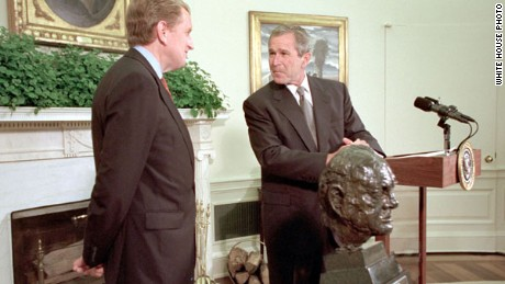 In 2001, then-UK Ambassador Sir Christopher Meyer and President George W. Bush discuss the handover of the Churchill bust.