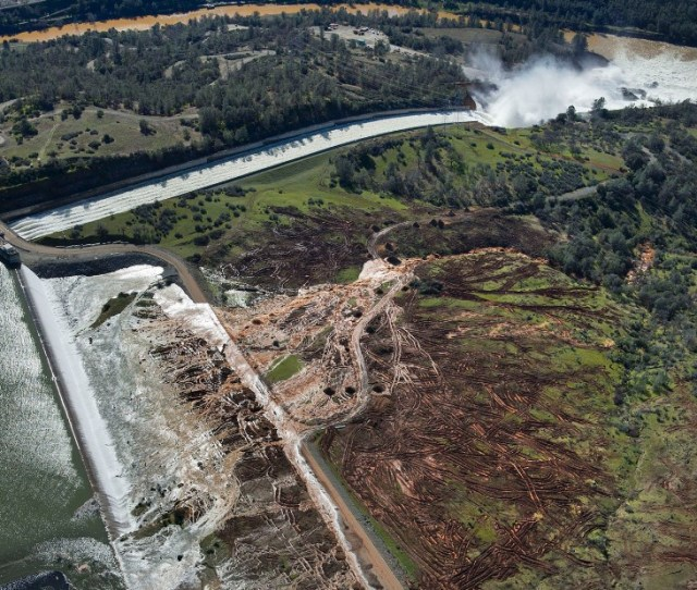 Water Flows Over An Emergency Spillway Bottom Right At Lake Oroville Dam On Saturday