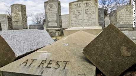 A headstone lies broken in two after vandalism at Mount Carmel Cemetery.