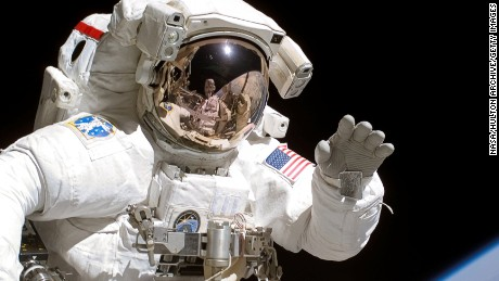 American astronaut Joseph Tanner waves to the camera during a space walk as part of the STS-115 mission to the International Space Station, September 2006. (Photo by NASA/Getty Images)