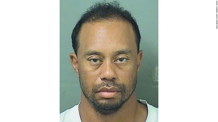 Tiger Woods' car had flat tires, he was asleep at wheel, police say