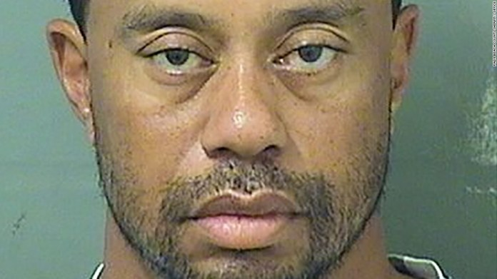 Tiger Woods' car had flat tires, he was asleep at wheel, police say