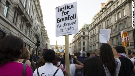 """Protesters march up Regent Street in London chanting """"Justice for Grenfell"""" on June 16, 2017, two days after the fire."""