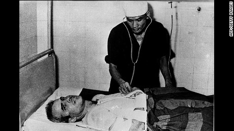 John McCain is examined by a Vietnamese doctor in 1967 after being captured in Hanoi.