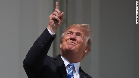 President Donald Trump looks up toward the Solar Eclipse on the Truman Balcony at the White House on August 21, 2017.