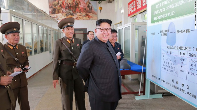This undated picture released from North Korean state media shows leader Kim Jong Un visiting the Chemical Material Institute of the Academy of Defense Science.