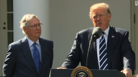 President Donald Trump (right) and Senate Majority Leader Mitch McConnell speak Monday in the White House Rose Garden.