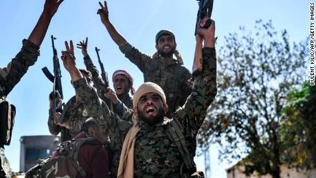 Syrian Democratic Forces celebrate in Raqqa.