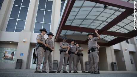 Florida Highway Patrol officers stood outside the Curtis M. Phillips Center on Wednesday as they prepare for Richard Spencer's speech.