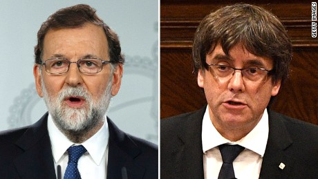 Rajoy, left, called Saturday for the removal of Catalan President Carles Puigdemont.
