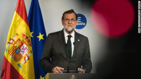 Mariano Rajoy answers questions during a news conference Friday in Brussels.