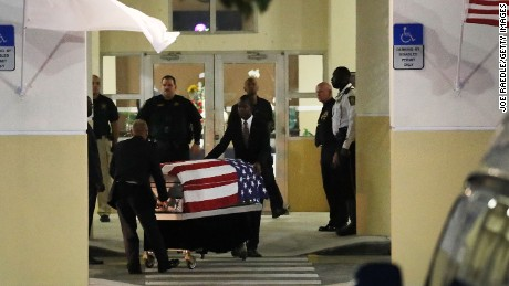The casket of Sgt. La David Johnson is moved following a wake for the soldier on October 20, in Cooper City, Florida.