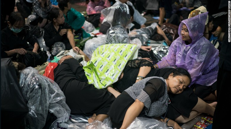 People sleep on the streets overnight on October 24 to attend Thailand's late King Bhumibol Adulyadej's cremation and funeral ceremony.