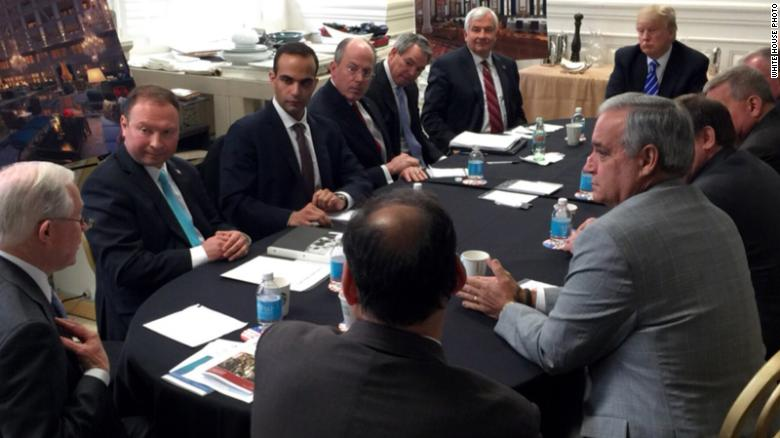 George Papadopoulos, pictured second from the left in March 2016 in a National Security Meeting with President Donald Trump, far right, and Jeff Sessions, far left.