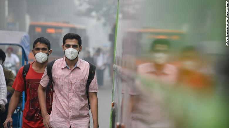 Many Delhi commuters have taken to wearing protective masks.