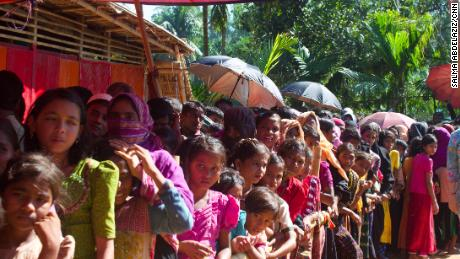 Women and girls wait for food aid in the Kutupalong refugee camp. The lines are segregated by gender.