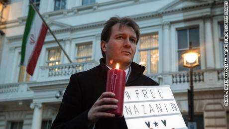 Richard Ratcliffe, husband of Nazanin Zaghari-Ratcliffe holds a '#Free Nazanin' sign and candle during a vigil for British-Iranian mother.