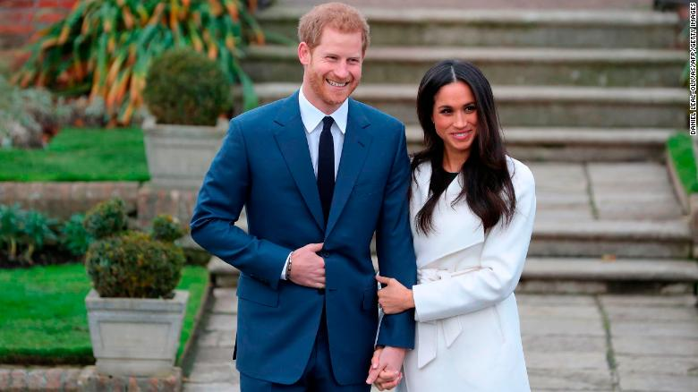 Prince Harry and fiancée Meghan Markle pose for photographers after their engagement was announced Monday.