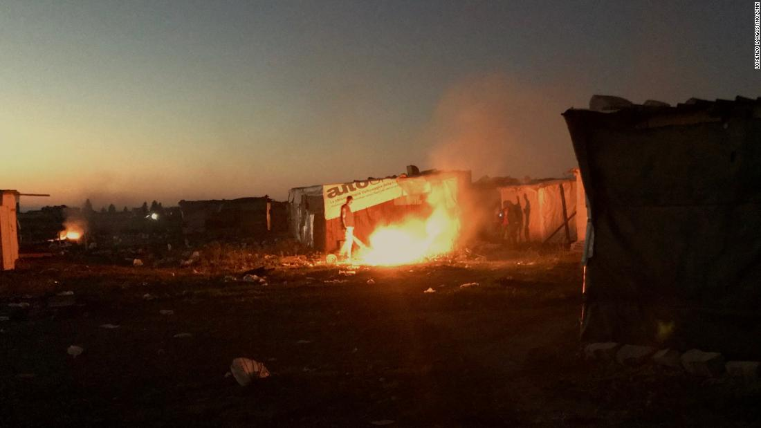 Burning trash at the Runway Ghetto.