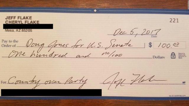Flake writes check to Democrat opposing Moore