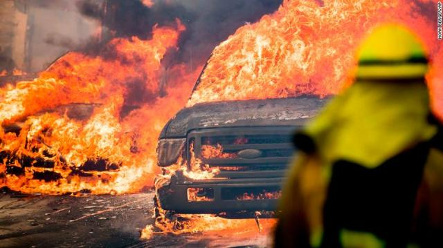 "Flames consume vehicles in Ventura on Tuesday, December 5, as wildfires rage in Southern California. The largest of the blazes, the <a href=""http://www.cnn.com/2017/12/06/us/ventura-fire-southern-california/index.html"">Thomas Fire</a>, started north of Santa Paula before spreading to Ventura, a coastal city just north of Los Angeles. Powerful Santa Ana winds and extremely dry conditions are fueling the wildfires in what has been a devastating year for fires in California."