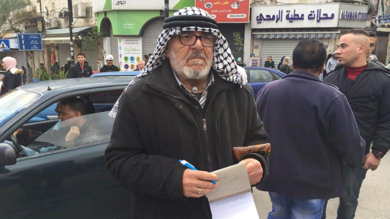 Naim Masarweh came to al-Manara square on Thursday to protest against Trump's announcement.