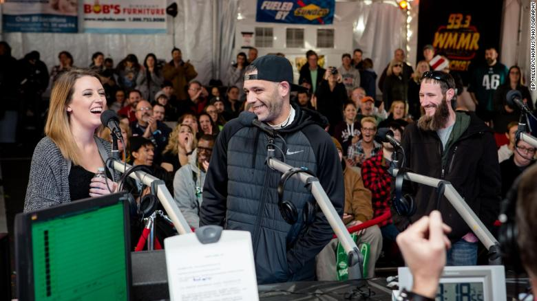 From left, Kate McClure, Mark D'Amico and Johnny Bobbit Jr. attend an event in Philadelphia.
