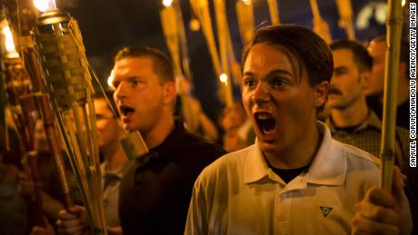 Neo-Nazis and white supremacists march and chant at counter-protesters in Charlottesville.
