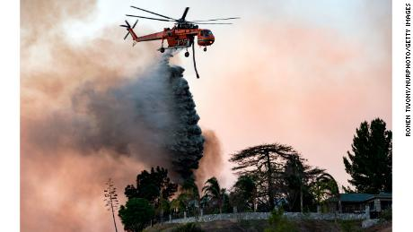 A helicopter makes a water drop over the Creek Fire on December 5, 2017, in Los Angeles.