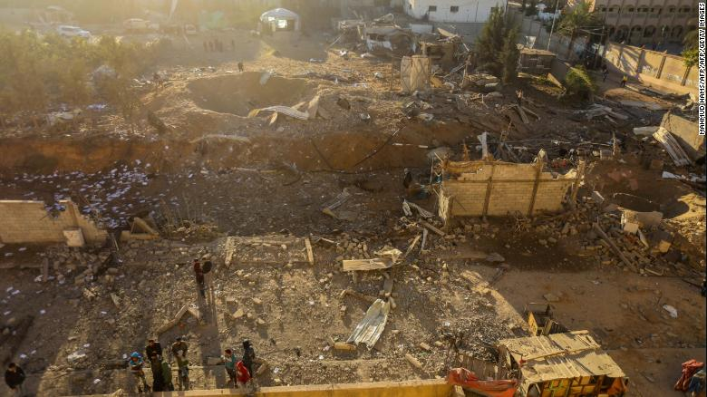 Palestinians look at damage Saturday after an Israeli airstrike in Beit Lahia in northern Gaza.