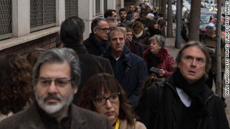 Voters line up outside a polling station in Barcelona, Spain.