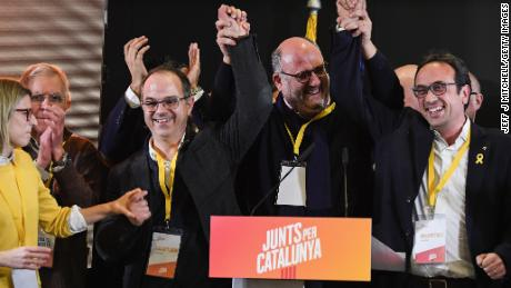 Junts per Catalunya candidates celebrate during a press conference following the Catalan regional election.
