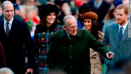 Britain's Prince Philip, Duke of Edinburgh gestures to the crowd.